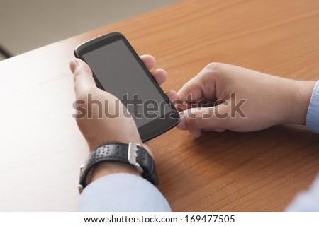 Close-up shot of aman Using Smartphone - stock photo