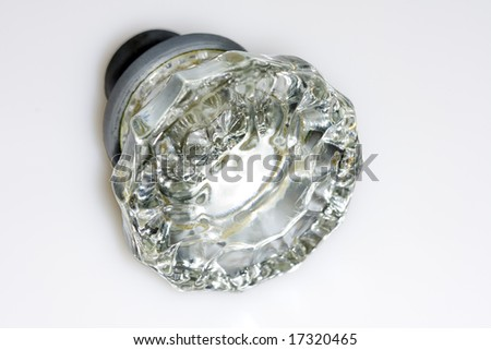 Close up shot of an antique glass doorknob on white background