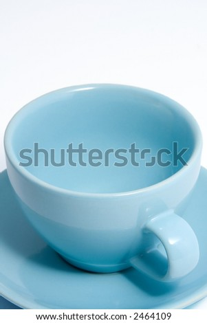 Close up shot of an empty blue coffee cup and saucer. - stock photo