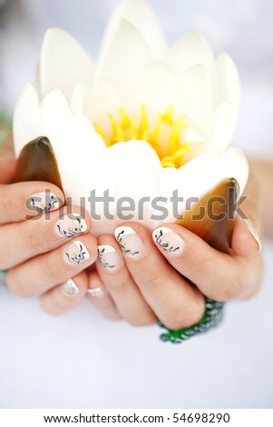 Close-up shot of art bridal manicure with painted nails - stock photo