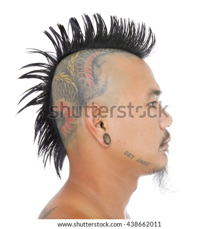 close up shot of asian punk's head with mohawk hair style, tattoo on head, ear and mouth piercing isolated on a white background
