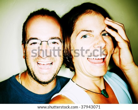 Close up shot of attractive couple laughing - stock photo
