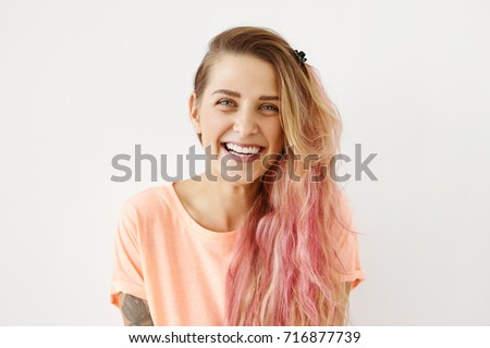 Pink hair highlights stock images royalty free images vectors close up shot of attractive positive young european female with long messy hair with pink highlights pmusecretfo Images
