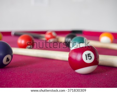 close up shot of 15 Ball from pool or billiards on a billiard table. Selective Focus.Billiard balls on the table - stock photo