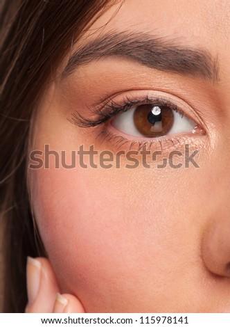 Close-up shot of beautiful woman eye with light makeup - stock photo