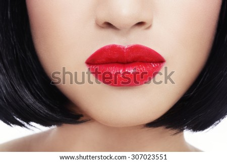 Close-up shot of beautiful woman's red lips over white background - stock photo