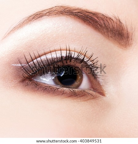 Close-up shot of beautiful young woman eye with face art  make up  - stock photo