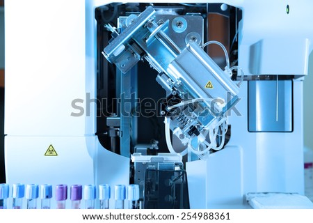 close up shot of blood test machine in laboratory take with blue filter  - stock photo