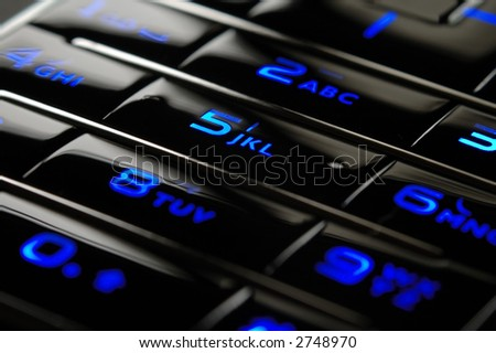 Close up shot of blue mobile keypad under dark environment - stock photo