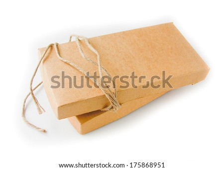 close up shot of brown paper box and string isolated background