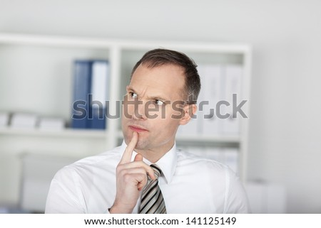 Close up shot of businessman thinking inside the office