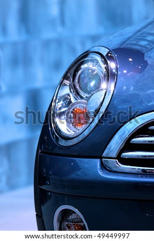 Close up shot of car head lamp in blue color tone - stock photo