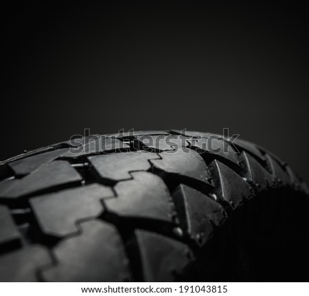 Close-up shot of classical motorcycle tire tread  - stock photo