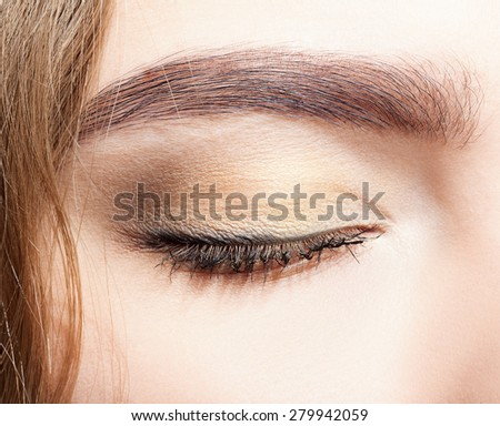 Close-up shot of closed female eye makeup