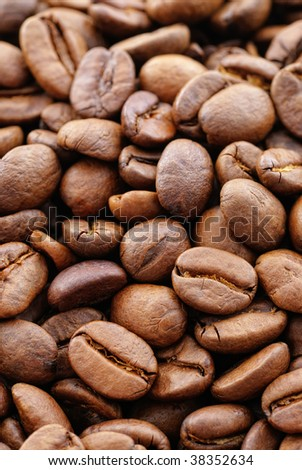 Close up shot of coffee beans. Focus on foreground. - stock photo
