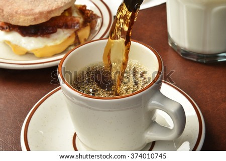 Close up shot of coffee being poured, high speed photography freezes motion - stock photo