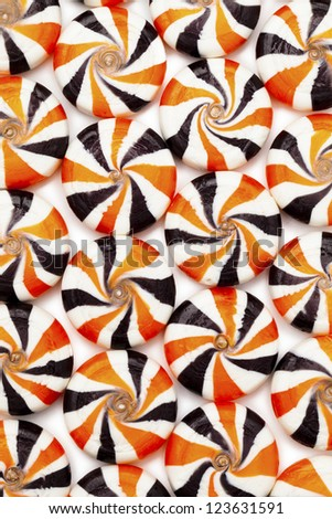 Close-up shot of colorful hard candies with swirl design arranged beside each other. - stock photo
