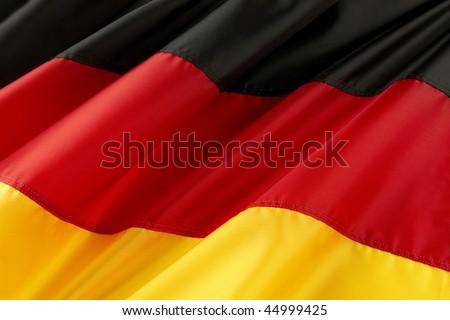 Close up shot of colorful, wavy German flag - stock photo