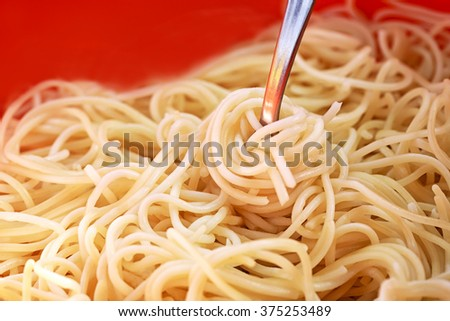 Close up shot of cooked spaghetti - stock photo