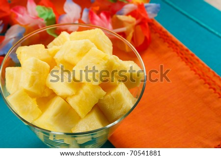 Close up shot of cut pineapple against a bright background of tropical colors