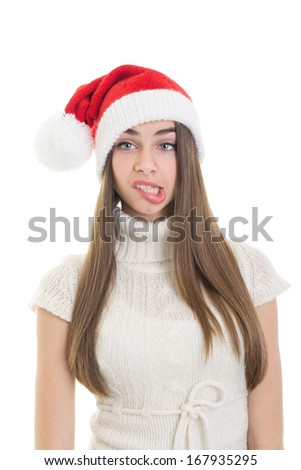 Close up shot of cute teenage Santa girl making funny facial expression wearing Santa hat isolated on white background. Christmas concept. - stock photo