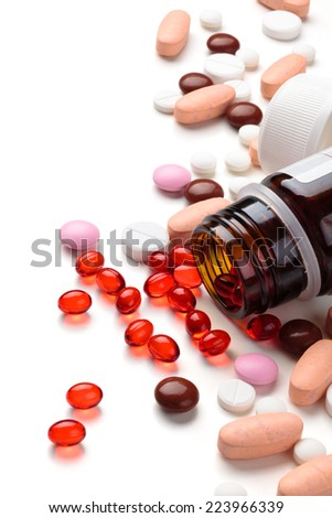 Close up shot of different pills isolated on white background. - stock photo