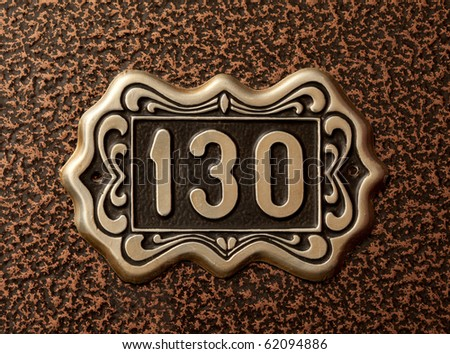 Close up shot of door with numerals 130. - stock photo