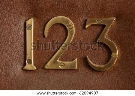 Close up shot of door with numerals 123. - stock photo