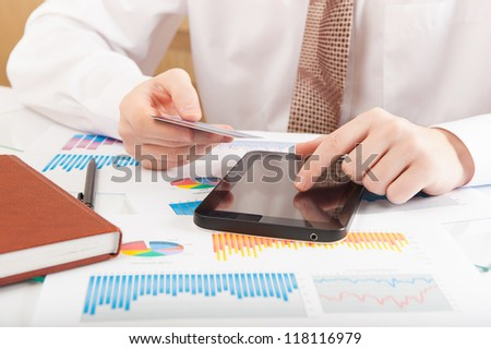Close up shot of entering credit card number - stock photo