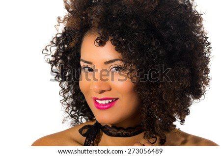 close up shot of exotic beautiful young smiling girl with dark curly hair posing isolated on white - stock photo