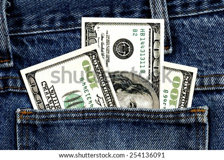 Close Up Shot Of Fake Hundred Dollar Bills In Jean Pocket/ Money In The Pocket - stock photo