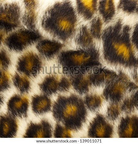 close up shot of fake leopard tiger fur texture background - stock photo