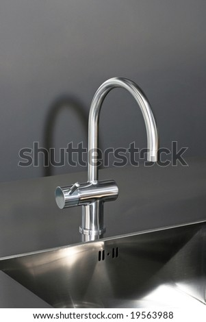 Close up shot of faucet and stainless sink
