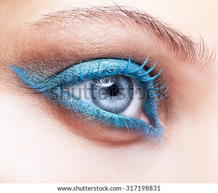 Close-up shot of female eye blue color make-up - stock photo