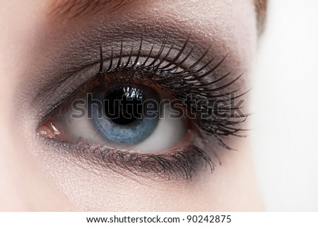 Close-up shot of female eye with bright fashion makeup - stock photo