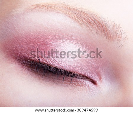 Close-up shot of female face with closed eye - stock photo