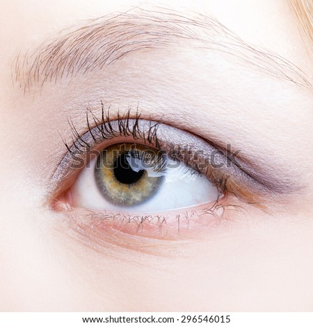 Close-up shot of female face with eye makeup - stock photo