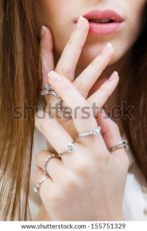 Close up shot of female hands with rings. Concept of wealth and luxurious life - stock photo