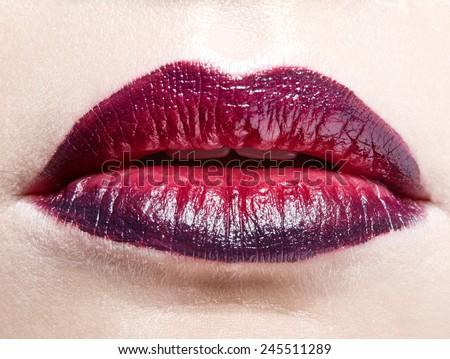 Close-up shot of female lips with bicolor marsala lipstick - stock photo