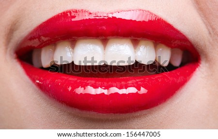 Close up shot of female red lips. Concept of fashion and sensuality - stock photo