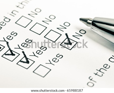 Close up shot of filled check boxes with pen - stock photo