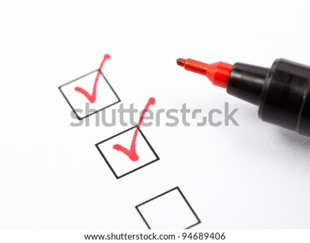 Close up shot of filled check boxes with red pen - stock photo