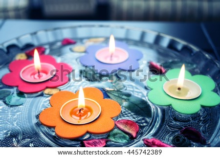 close up shot of floating candles in glass bowl.  - stock photo