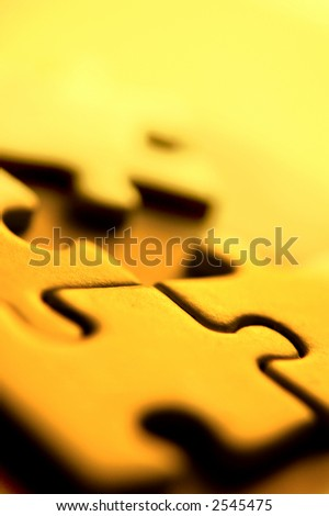 Close up shot of four puzzle pieces. - stock photo