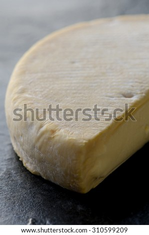 Close up shot of french reblochon cheese piece.