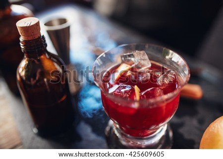 Close up shot of fresh negroni cocktail made from skilled bartenders - stock photo