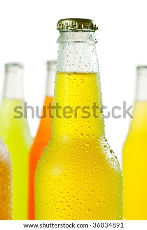 Close up shot of glass bottle with water drops - stock photo