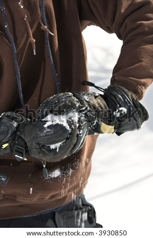 Close up shot of gloved hands making snowball. - stock photo