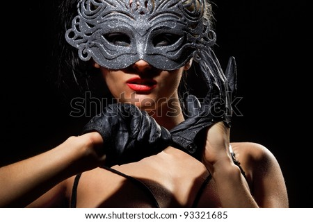 Close up shot of gorgeous Incognito woman in ancient style mask - stock photo
