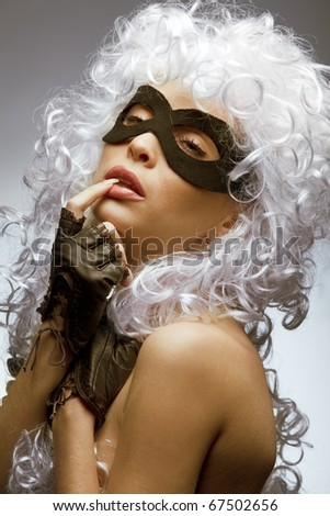 Close up shot of gorgeous Incognito woman in ancient style wig and mask - stock photo